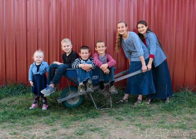 Group of kids in a wheel barrow
