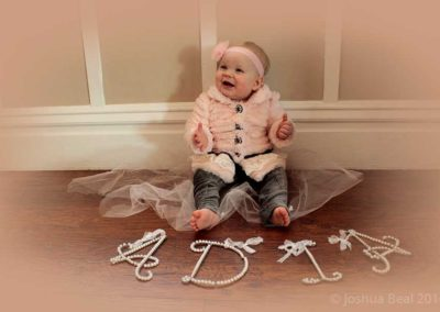 Name in front of baby for her firrst birthday