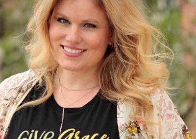 "Model in ""Give Grace Speak Peace"" shirt design"