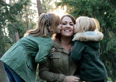 Girls kissing their Mama on the cheek