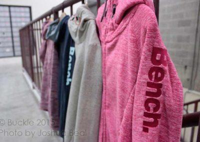 Hooded sweatshirts in a row