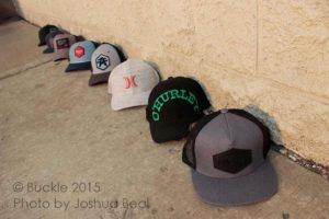 Hats along a wall