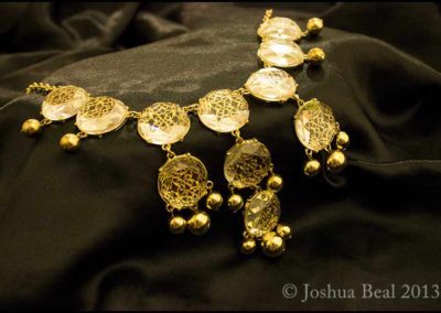 Gold necklace with clear jewelry