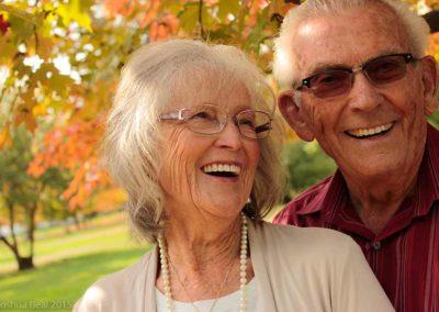 Elderly couple laughing