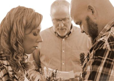 Couple in prayer in wedding ceremony