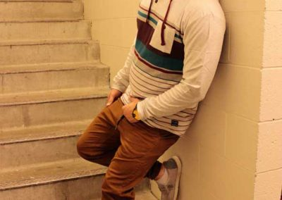 Man relaxing in a stairwell