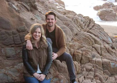 Portrait of a young couple on a rocky beach 2