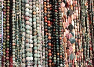 Drapes of earth-toned bead necklaces