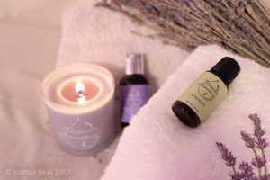 Candle, towels, and lavender