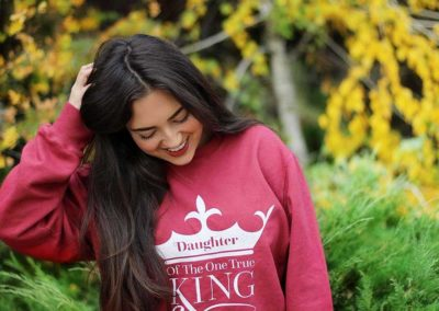 Model in Daughter Of The One True King shirt
